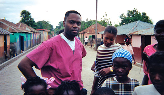 Paul Alphonse Jr., MD '98, during the first Project Haiti medical outreach trip in 1996, notifies residents about the health fair organized by his team from the College of Medicine.