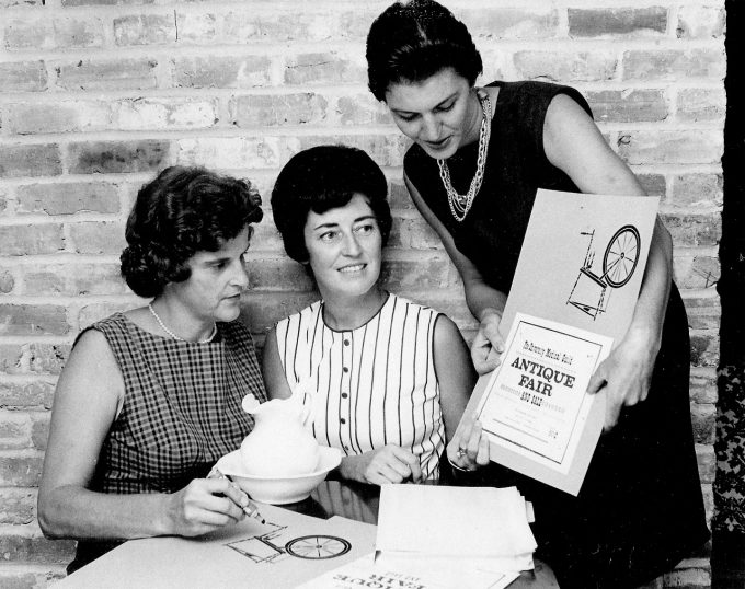 UF Medical Guild membrs Mary Moreland, Marion Freund, and Anita Palmer prepare for the 1965 Antique Fair and Sale.