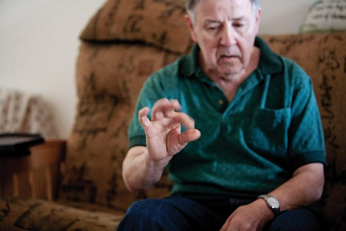 "Just months after DBS surgery, McCabe shows off his ""new arm"" by tapping his forefinger and thumb together repeatedly – something his Parkinson's tremors had prevented him from being able to do before. Photo by Jesse S. Jones"