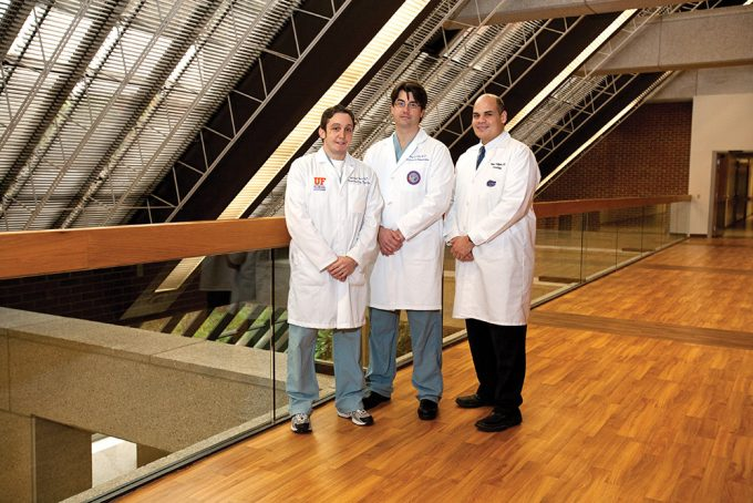 (left to right) Michael S. Okun, MD '96, is a neuroscientist and neurologist and co-directs the UF CMDNR with Kelly Foote, MD, a neurosurgeon. Ramon L. Rodriguez, MD, is clinic director and rounds out the trio that orchestrates care, which involves more than 10 additional specialists from multiple disciplines. The full spectrum of expertise and care provided at the center is world-renowned and recognized for its patient-centered approach. Photo by Jesse S. Jones