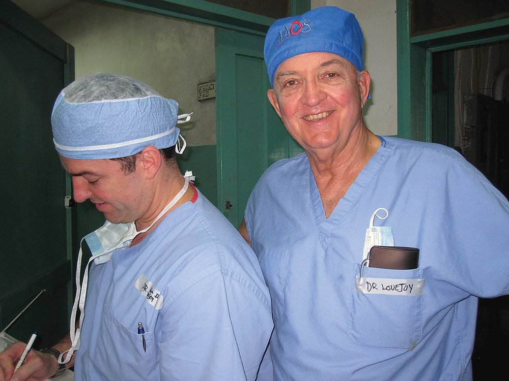 Dr. John Lovejoy Jr., MD '66, (right) and his son, John Lovejoy III, MD '01, on a recent trip to Haiti.