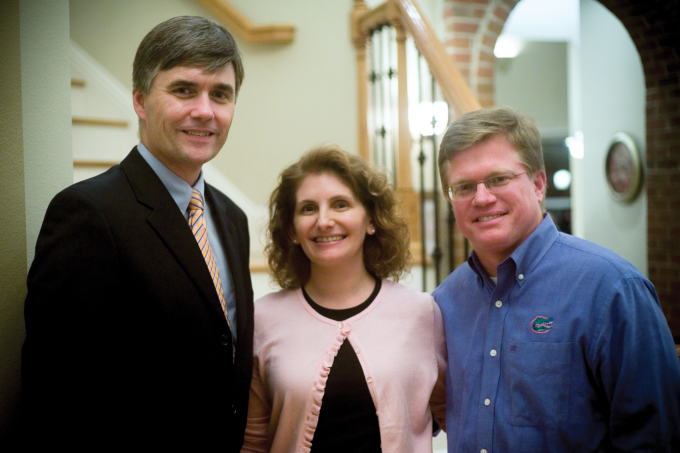 Drs. Steve and Gina Sevigny, both UF COM class of 1994 graduates, with Dean Michael L. Good, MD, at their home during a meet-the-dean event in 2009. The Sevignys are strong supporters of the college and the dean's vision for a new medical education building.
