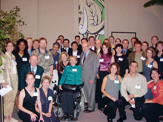"Caroline Cox-Signore, MD '92, is surrounded by her classmates during their 10-year reunion in Gainesville with the late Dr. Hugh ""Smiley"" Hill in 2002."